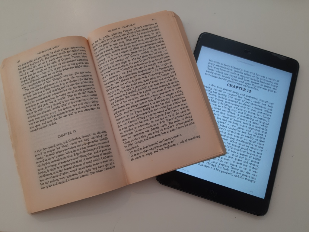 Image of paperback copy of Northanger Abbey and iPad Kindle copy of Northanger Abbey, open to the same chapter. The text is displayed differently on each interface.