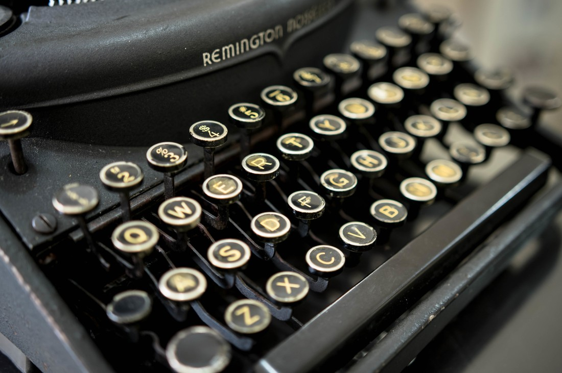 Close up of old Remington typewriter with circle-shaped keys.